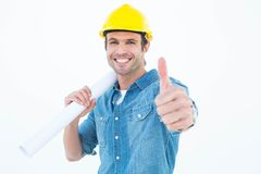 Architect holding blueprint while gesturing thumbs up Stock Photos