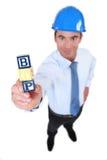 Architect holding building blocks. Architect holding toy building blocks stock photos