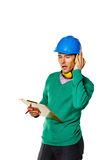 Architect holding a checklist. Builder closed ears earplugs. Royalty Free Stock Photo