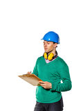 Architect holding checklist. Builder makes a mark in plan. Royalty Free Stock Photography