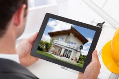 Architect holding digital tablet Stock Photo