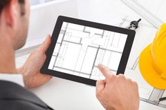 Architect holding digital tablet Stock Image