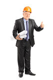 Architect holding documents and giving thumb up Stock Image