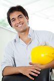 Architect Holding Hardhat Royalty Free Stock Images