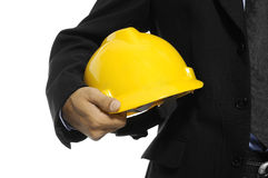 Architect Holding Helmet. Detail of an architect holding helmet, isolated over white Stock Photography