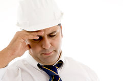 Architect holding his head in pain Stock Images