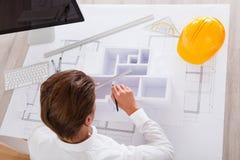 Architect Holding House Model Stock Photo