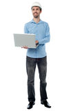 Architect holding laptop and looking upwards Royalty Free Stock Photo