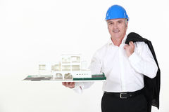 Architect holding a miniature house Royalty Free Stock Photos