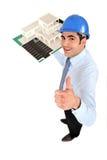 Architect holding model housing. Male architect holding model housing Royalty Free Stock Image