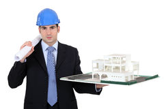 Architect holding model housing Stock Images