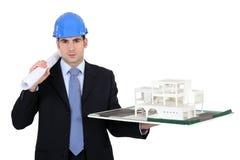 Architect holding model housing Stock Images
