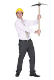 Architect holding pickaxe Royalty Free Stock Images