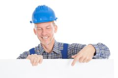 Architect holding placard Stock Photo