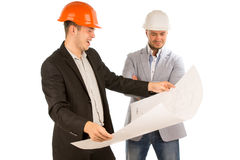 Architect holding a plan watched by his partner Stock Photo
