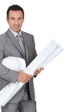 Architect holding plans Stock Image