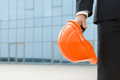 Architect holding protective helmet Stock Photo
