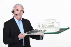 Architect holding replica of housing Royalty Free Stock Photo