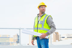 Architect holding rolled up blueprints outdoors Royalty Free Stock Photography