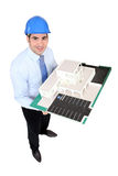 Architect holding a scale model Stock Photos