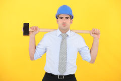 Architect holding sledge-hammer Royalty Free Stock Photos