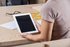 Architect Holding Tablet Computer At Table Royalty Free Stock Image
