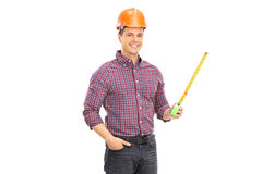 An architect holding a tape measure Stock Image