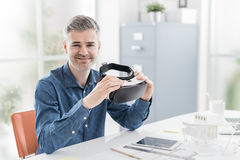 Architect holding a VR headset Royalty Free Stock Images