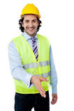 Architect holds out his hand for a handshake Royalty Free Stock Photo