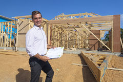 Architect with home plans Royalty Free Stock Image