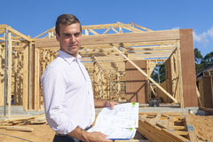 Architect with home plans Royalty Free Stock Photo