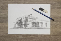 Architect Home Sketch. Shoot Of Architect Drawings on desk Royalty Free Stock Images