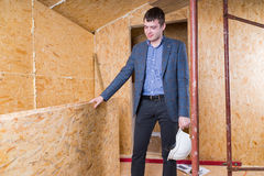 Architect Inspecting Boards Inside Unfinished Home Royalty Free Stock Image