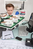 Architect inspecting model housing Royalty Free Stock Images