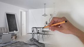Architect interior designer concept: hand drawing a design interior project while the space becomes real, white modern living room. In scandinavian style stock image