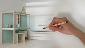 Architect interior designer concept: hand drawing a design interior project while the space becomes real, white wooden modern chil. Architect interior designer royalty free stock image