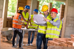 Architect and investiture consider possibilities at site Royalty Free Stock Images