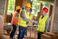 Architect and investiture make deal Stock Photos