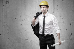Architect with jacket over his shoulder Stock Photo
