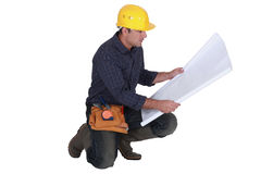 Architect kneeling Stock Image