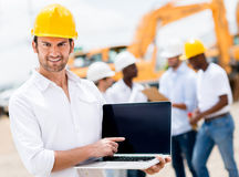 Architect with a laptop computer Stock Photo