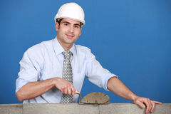 Architect laying a block Stock Images