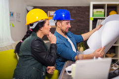 Architect looking the architectural plans in office. Royalty Free Stock Photography