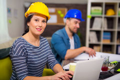 Architect looking the architectural plans in office. Royalty Free Stock Images