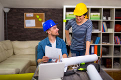 Architect looking the architectural plans in office. Stock Photography