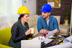 Architect looking the architectural plans in office. Stock Images