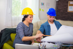 Architect looking the architectural plans in office. Stock Photos