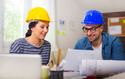 Architect looking the architectural plans in office. Stock Photo