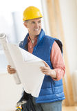 Architect Looking Away While Holding Blueprint At Construction S Royalty Free Stock Photography