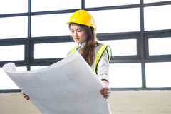 Architect looking at blueprint Stock Photography